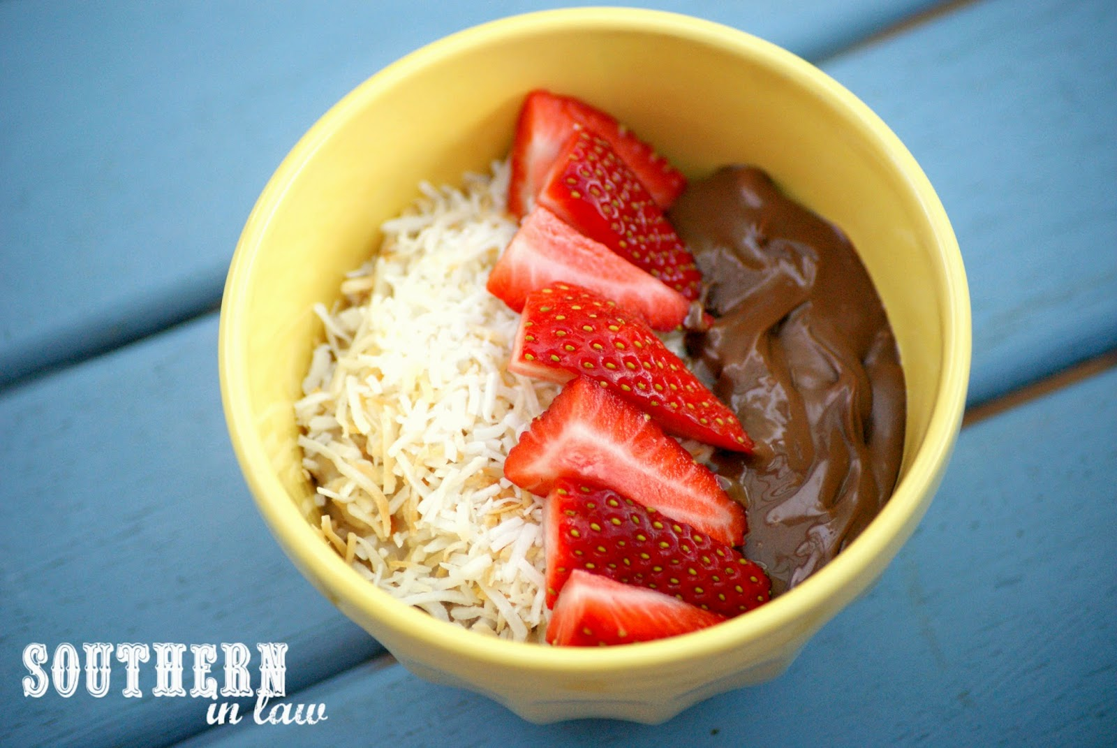 Oatmeal with Chia Seeds, Fresh Strawberries, Nutella and Toasted Coconut