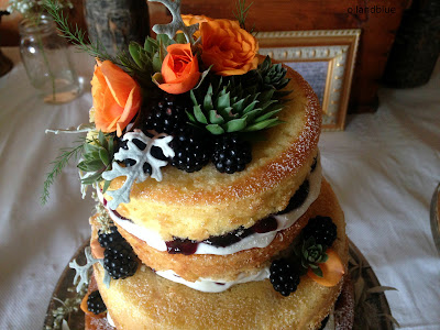 Naked Wedding Cake with Succulents, Dusty Miller, and Roses (white chocolate with blackberry jam) from oilandblue