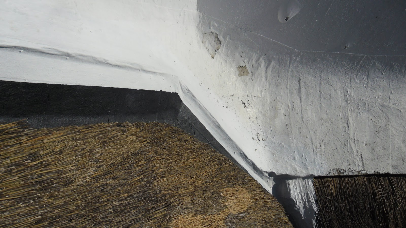 A Solution To Parapet Wall Drainage On Thatch Roofs