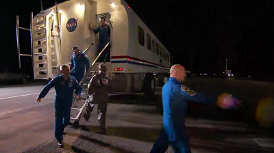The crew emerges from the people transporter after medical check-up. NASA 2011.