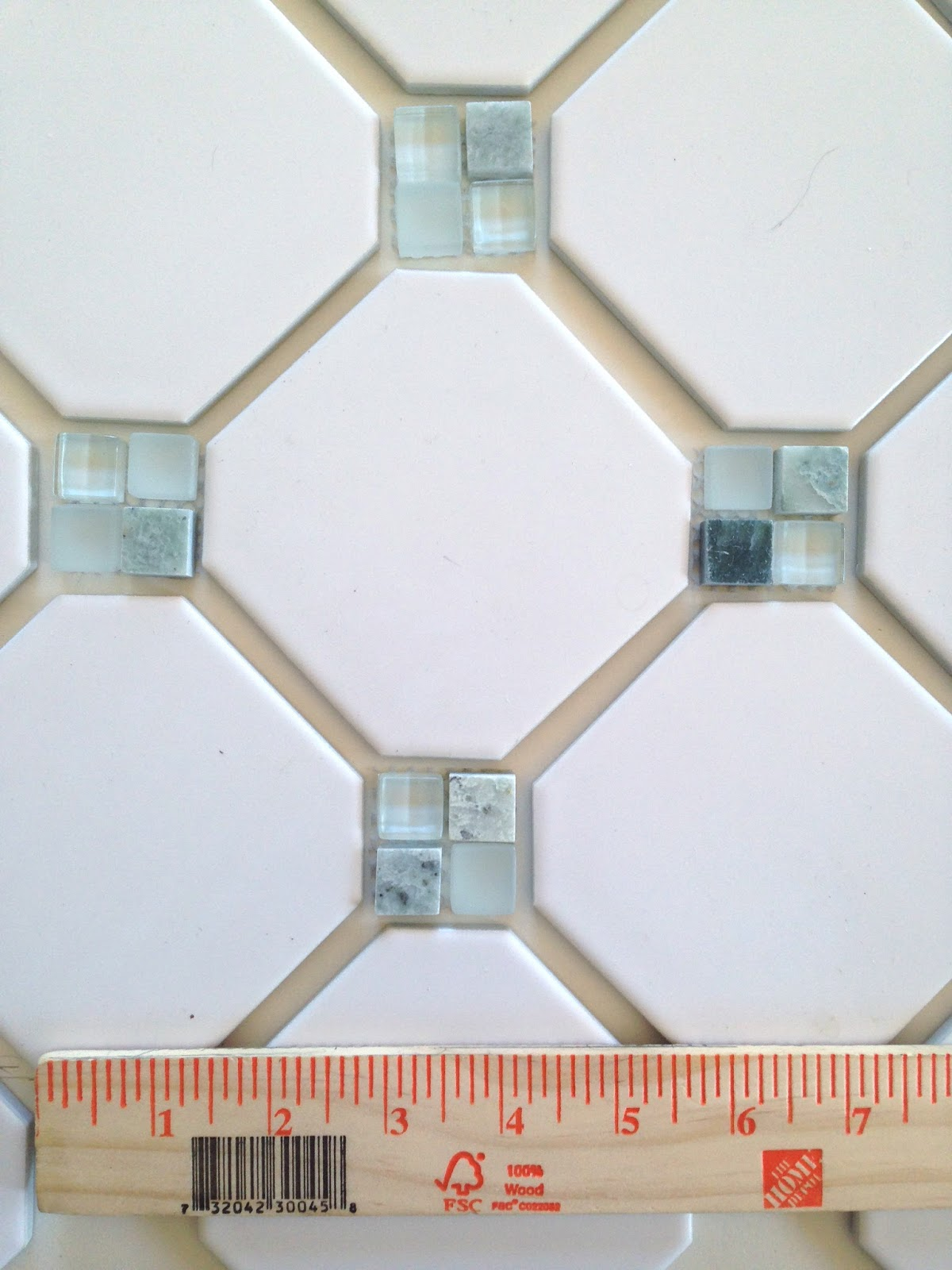Laying out an octagon and dot pattern - white matte finish octagon tile and natural stone and glass mosaic