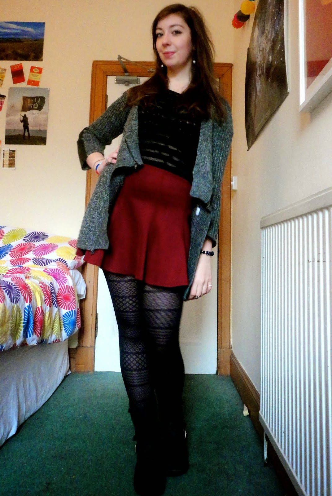 Outfit of grey wool cardgian, black striped top, red skirt, patterned tights and black boots