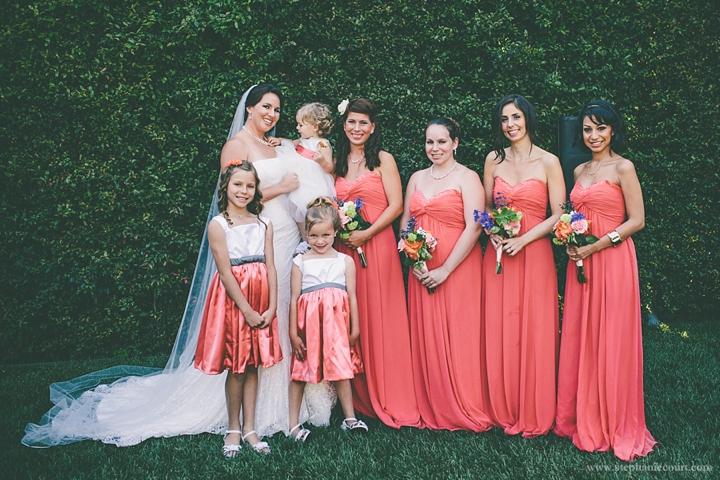 """bridesmaids in coral floorlength dresses at los angeles garden wedding"""