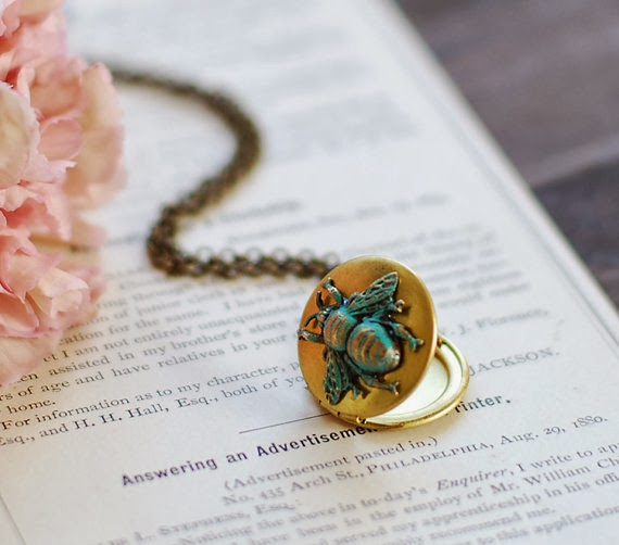 https://www.etsy.com/listing/117934442/bee-locket-necklace-gold-brass-locket?ref=shop_home_active_7&ga_search_query=bee