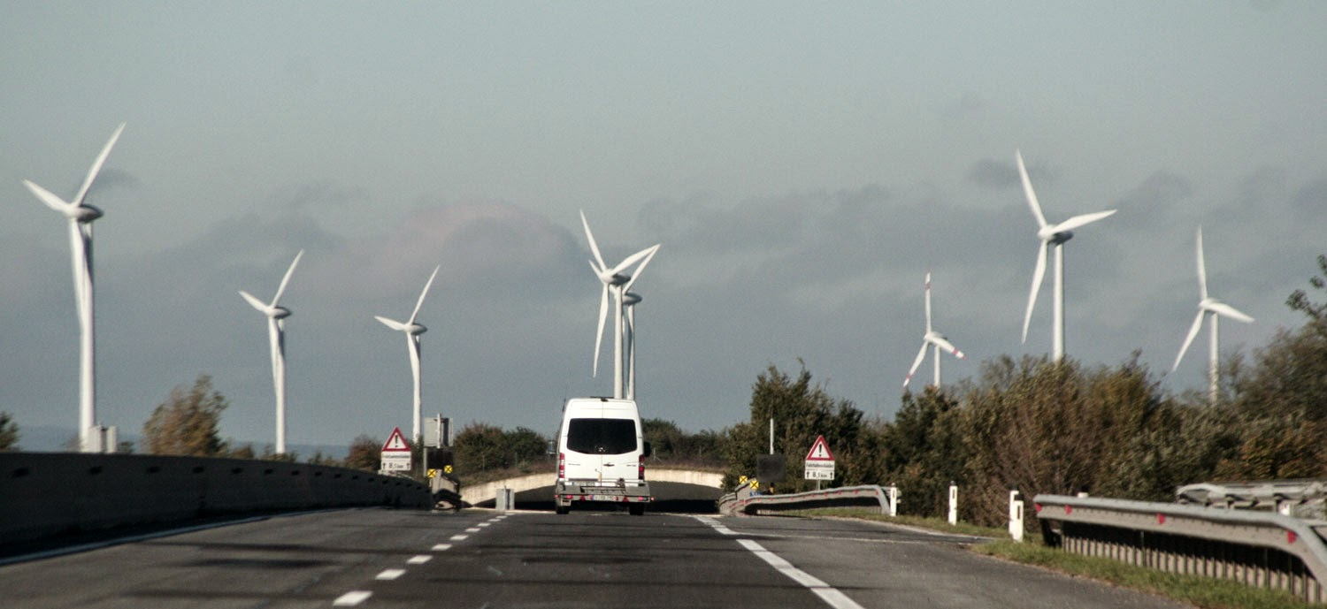 Huge wind turbines as the road goes under and eco bridge