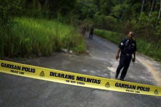القبض على أجنبية بعد انتشار صور عارية لها فوق أعلى جبل في ماليزيا