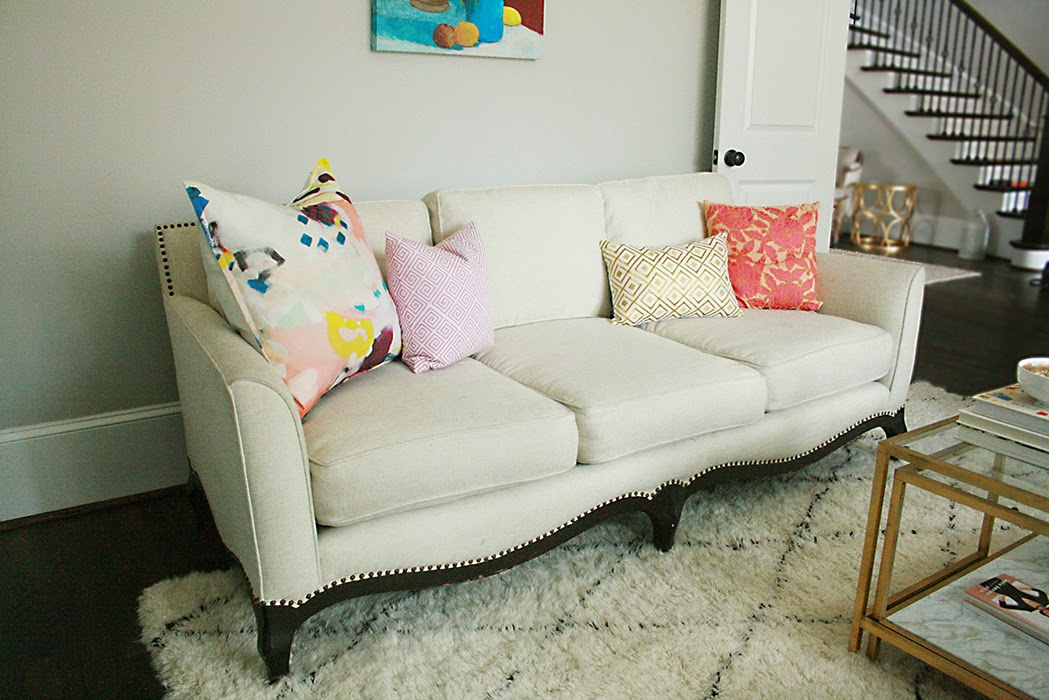 colorful pillows on white sofa in office setting modern meets vintage sofa shape