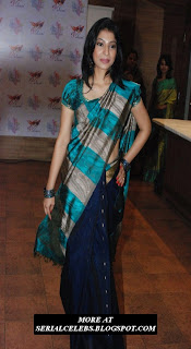 Anuja Iyer in low hip saree