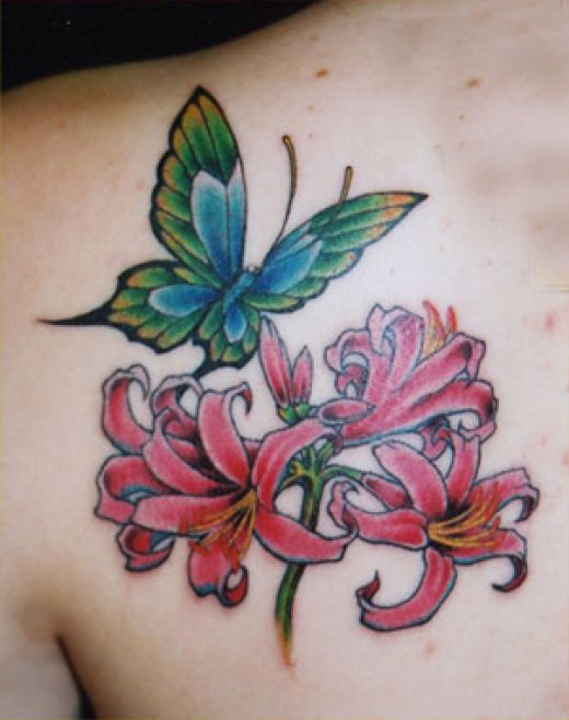 Nice lil butterfly tattoo designs flying over a flower tis such a lovely