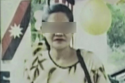 photo of beheaded 70-year-old mother