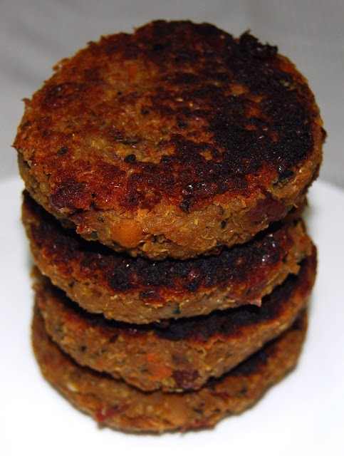 Side shot of stacked vegan quinoa and bean burger patties