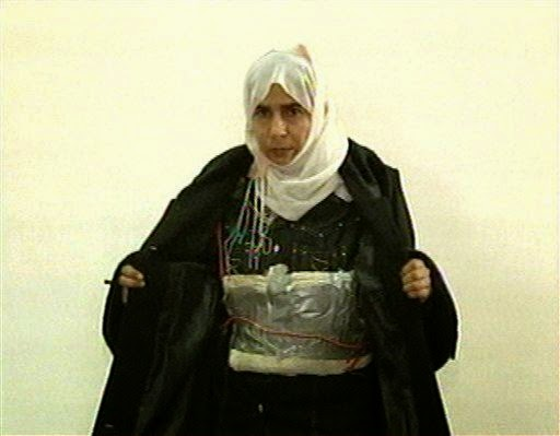 Sajida al-Rishawi opens her jacket and shows an explosive belt as she confesses on Jordanian state-run television to her failed bid to blow herself up in a hotel.