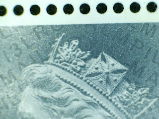 Close up of 5p Machin stamp showing security codes.