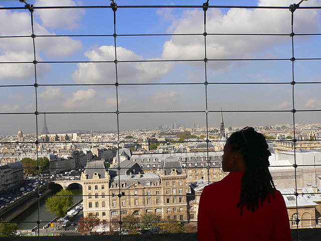 black woman on top of notre dame