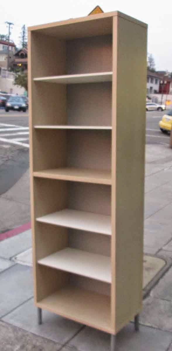 Uhuru Furniture & Collectibles Sold Tall Bookcase On Feet