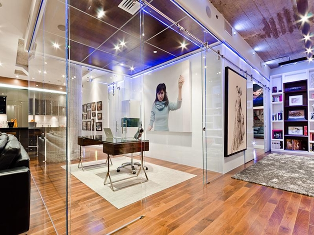 Glass cube as an home office inside of living room