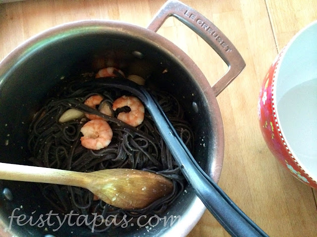 Squid Ink Pasta with Prawns recipe - tossing together