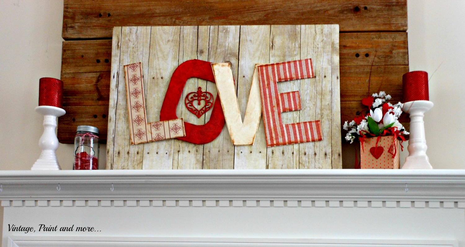 Dollar Store items and scrapbook paper used to DIY a simple Valentine mantel