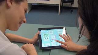 Children playing with Popplet on an iPad