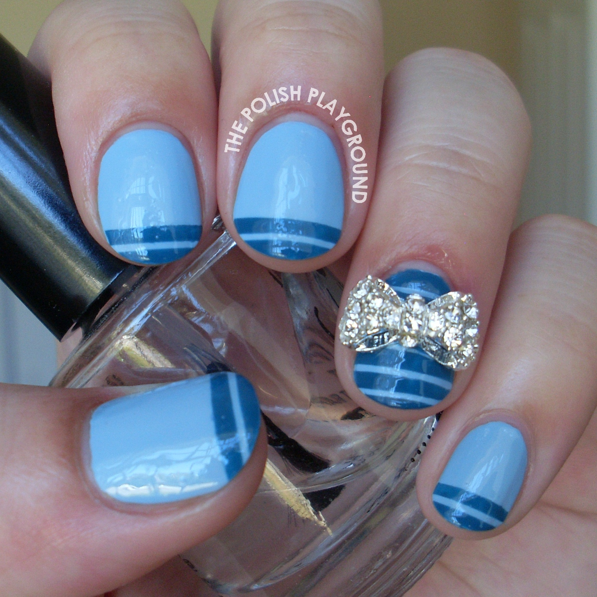 Blue Tip Stripes with Bow Stud Nail Art