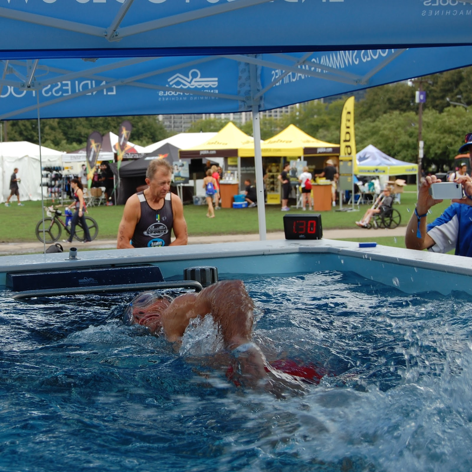 Pool with current to swim against - Test Swimming In The High Performance Endless Pool At A Triathlon Expo