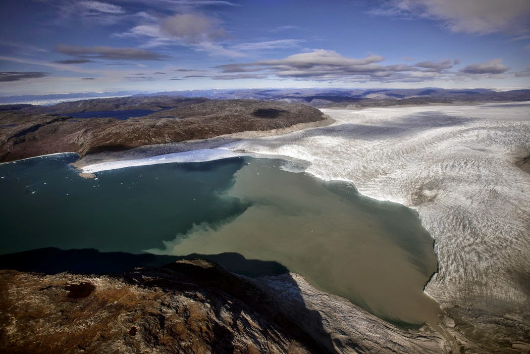 Where ice once capped the Sermeq Avangnardleq glacier in Greenland, vast expanses of the Arctic Ocean are now clear. (Credit: Kadir van Lohuizen / The New York Times) Click to enlarge.