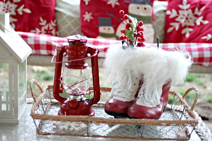 Red and white holiday decor on outdoor patio - www.goldenboysandme.com