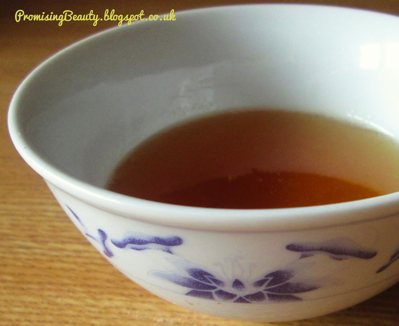 bowl of honey is small asian dipping bowl.