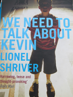 we need to talk about Kevin, Lionel Shriver, review, paperback, bookcover, little boy, creepy, disturbed, school shooting,