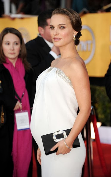 A pregnant and glowing Natalie Portman in a fitted white strapless column gown from Azzaro at the 17th Annual Screen Actors Guild Awards held at The Shrine Auditorium on January 30, 2011 in Los Angeles, California.