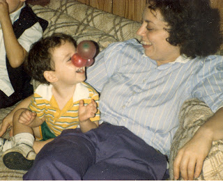 Author Benjamin Rubenstein as a toddler playing with his mother at his birthday party