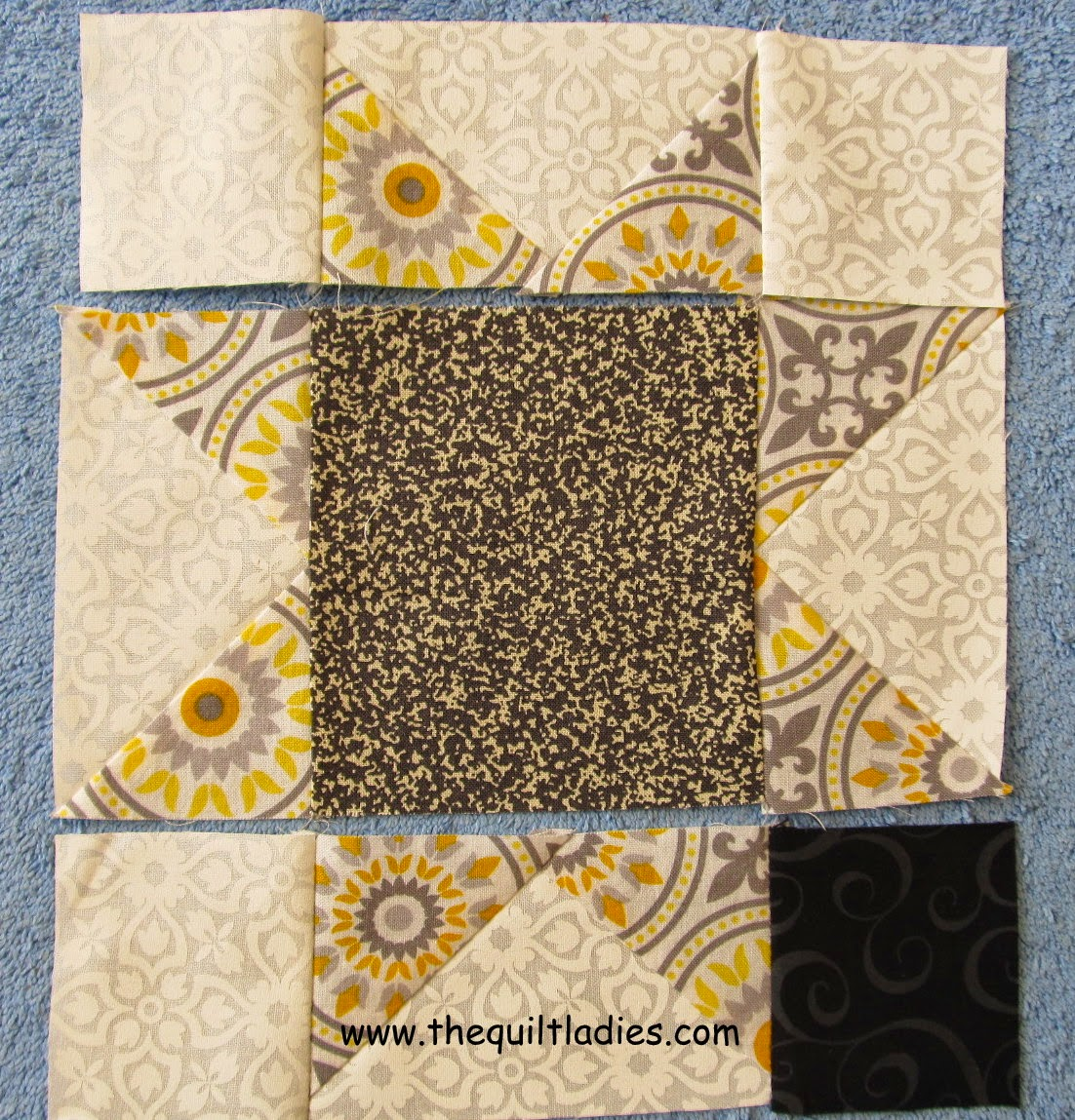 Star quilt pattern block in yellow and black