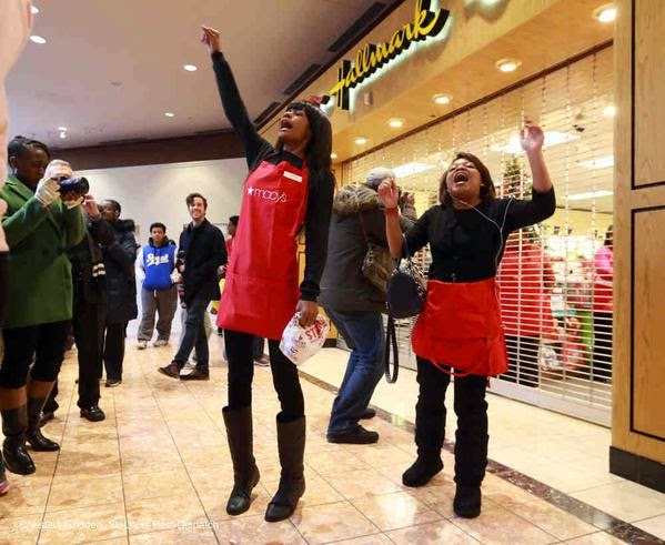 "Two women from Macy's lead a chant ""No Black Friday"""