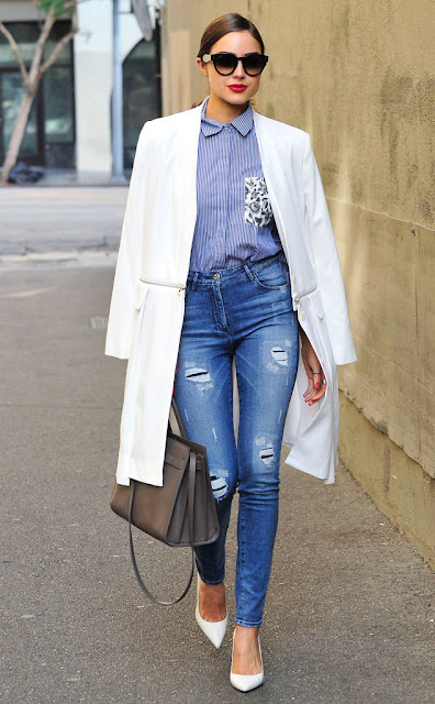 Olivia Culpo struts her stuff in West Hollywood in a striped button up shirt, high waisted jeans, a white coat and pumps