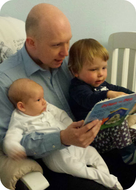 daddy reading to boys, father and sons, father reading to children