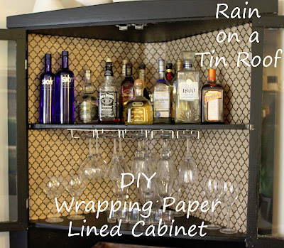 Wrapping Paper Lined Cabinet {rainonatinroof.com} #wrapping #paper #cabinet #stylish #storage