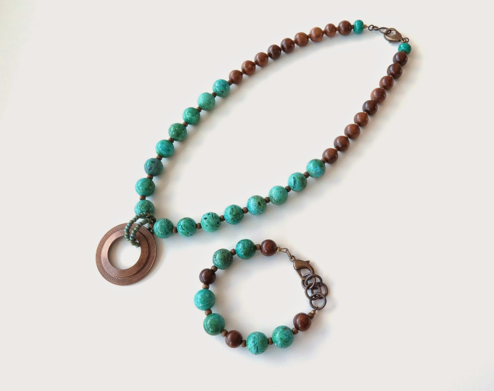http://sashaandmax.bigcartel.com/product/alia-green-agate-and-wood-necklace