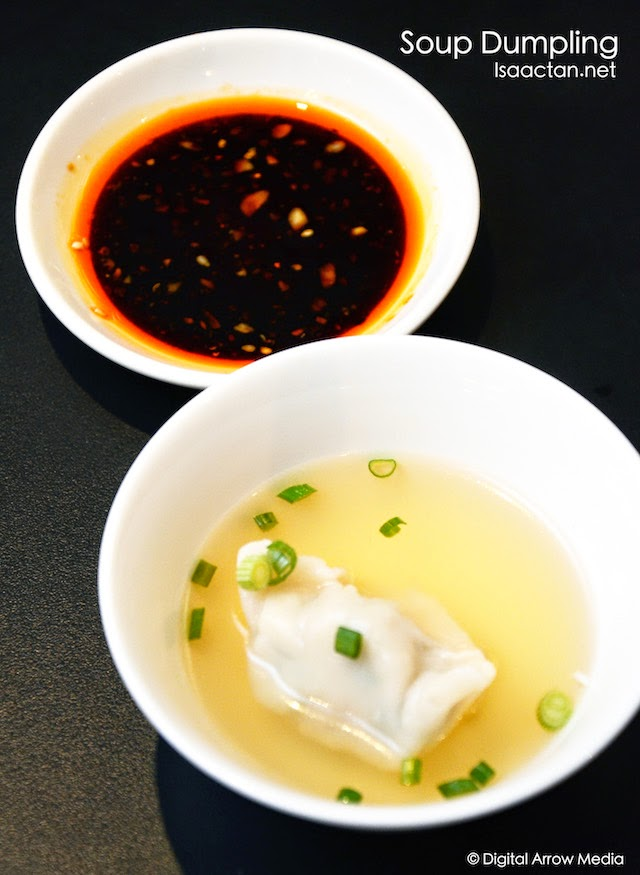 Dumpling in chicken soup served with Sichuan chili oil sauce