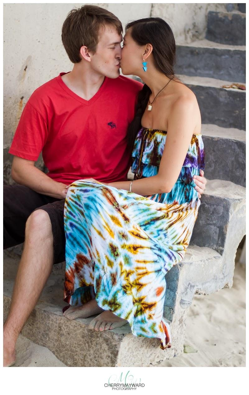 couple kissing on steps, koh samui honeymoon, thailand wedding photographer