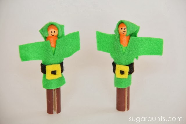 Small world pretend play for St. Patrick's Day with leprechaun peg dolls.