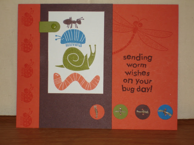 "Orange card with brown panel. Focal image is four bugs stacked on top of each other. Sentiment reads ""Sending worm wishes on your bug day."""