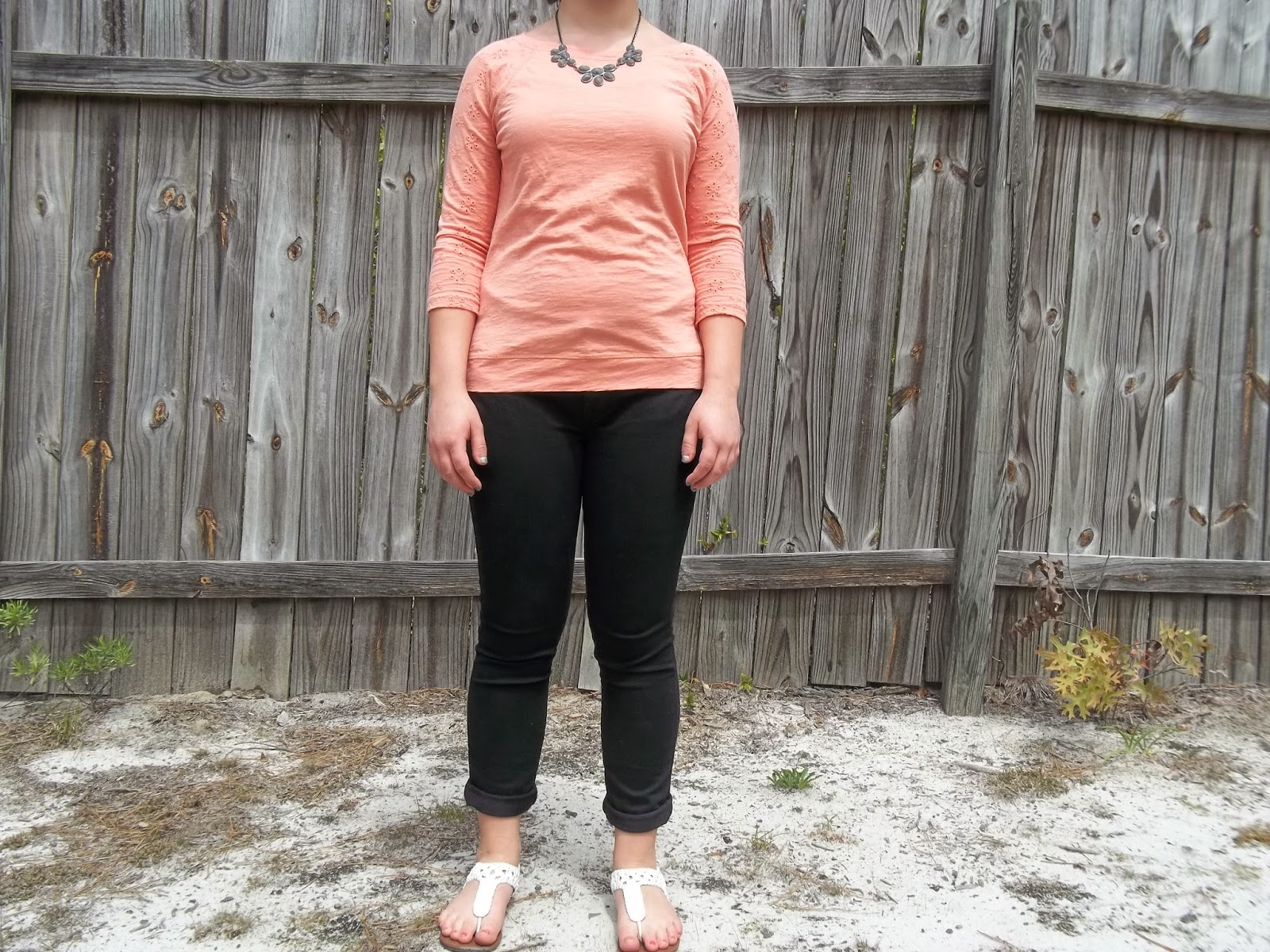 Peach and Grey. Peach eyelet top, black skinny jeans, grey statement necklace, white sandals. http://mybowsandclothes.blogspot.com. #peach #outfit #outfitpost #eyelet #BowsandClothes