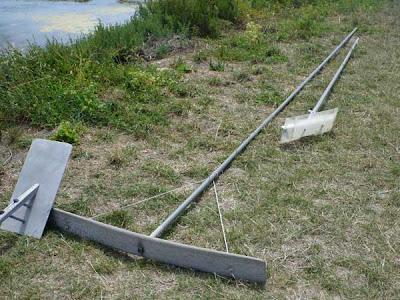 a paludier's salt rake used to harvest fleur de sel
