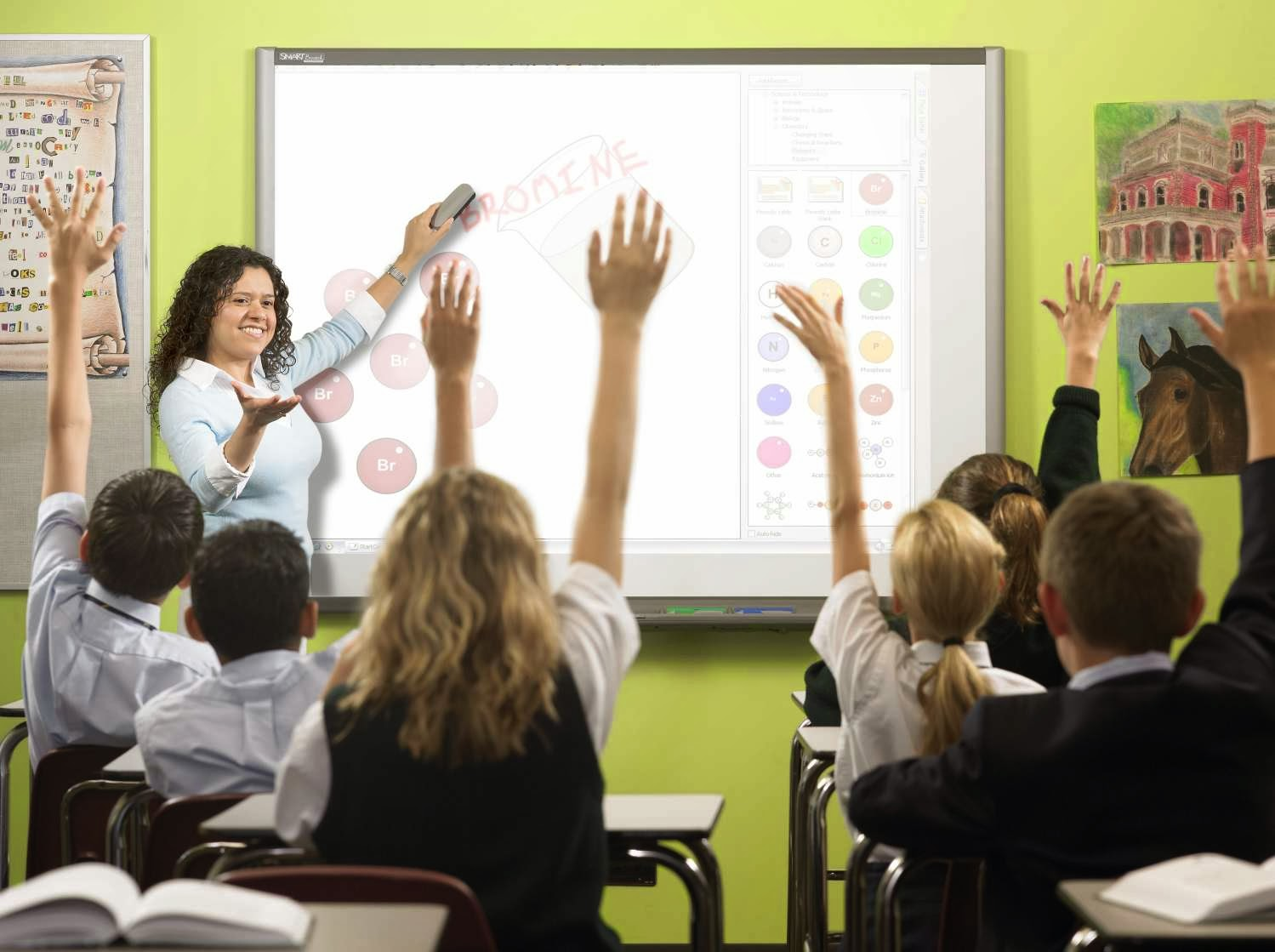 Teacher teaching using a smartboard