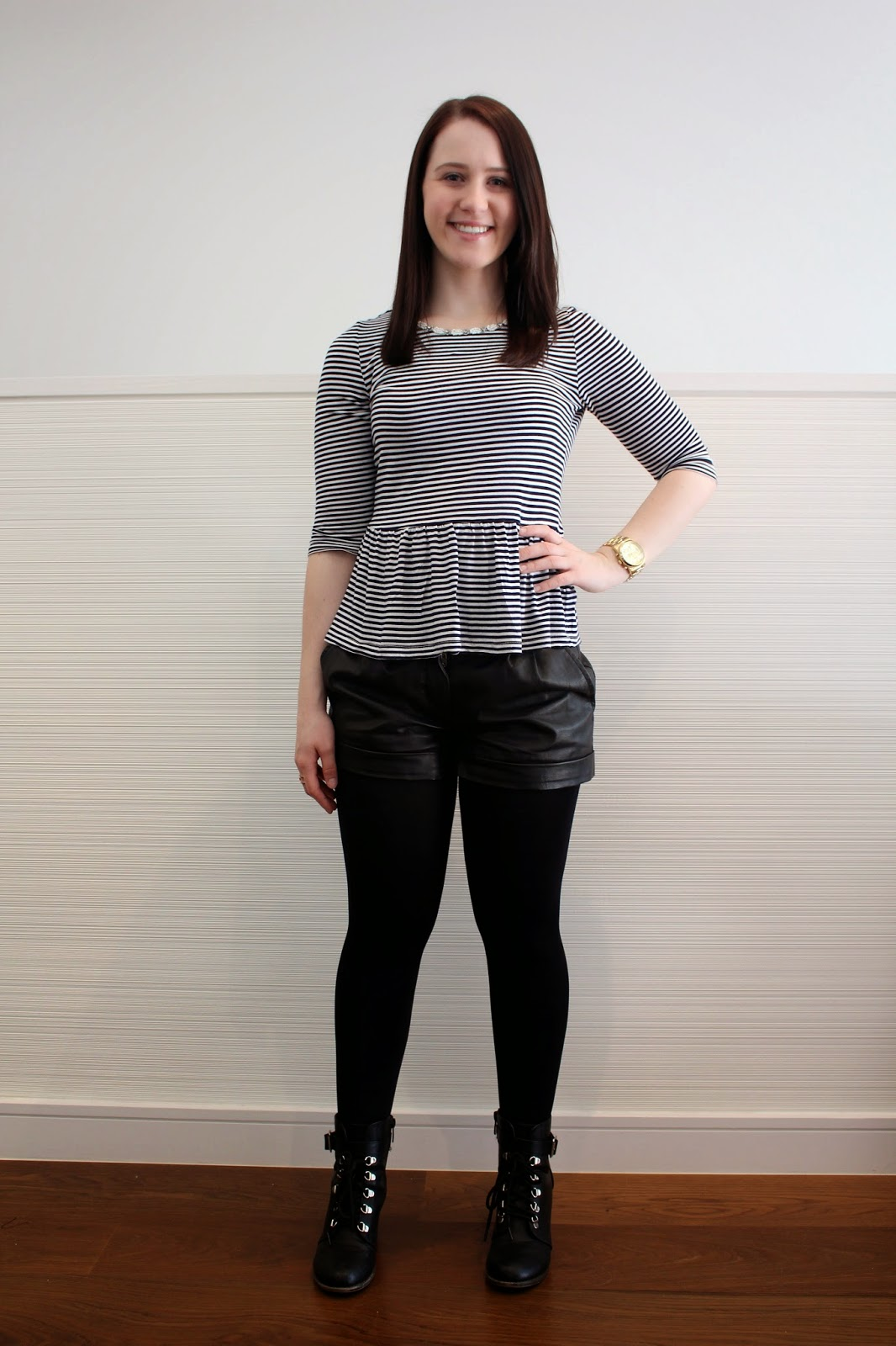 leather shorts, opaque tights, striped peplum top, denim jacket, michael kors gold watch, gold lovisa ring, spring outfit, autumn outfit, fall outfit, winter outfit, tights and biker booties, everyday outfit, college outfit, uni outfit, petite girl outfit, short girl outfit