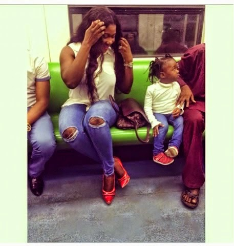 Mercy Johnson in a train