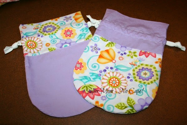 http://www.supermomnocape.com/2014/08/28/how-to-make-two-drawstring-bags-from-two-fqs/