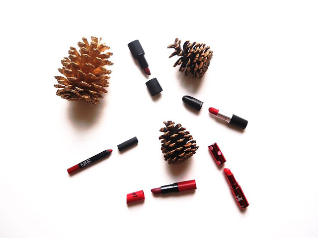 best red lipsticks, best christmas lipsticks, festive lipsticks, NARS, velvet matte lip pencil, cruella, Rimmel kate moss, 107, Benebalm, MAC, Ruby Woo, Sleek Cherry, swatches