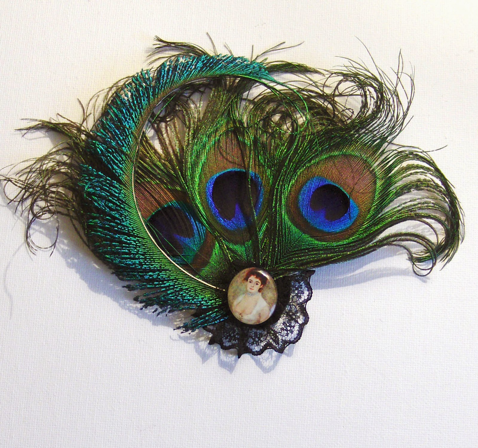https://www.etsy.com/uk/listing/185167070/peacock-feather-cameo-fascinator-uk?ref=shop_home_active_11
