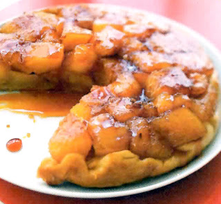 Classic pineapple tarte tatin (upside down tart) with a wedge removed